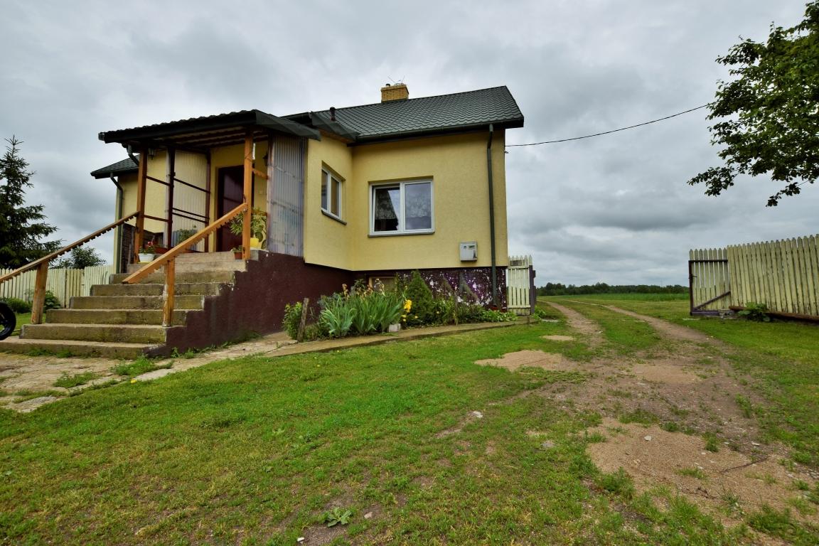 Siedlisko i grunty rolne pod miastem 4,02ha, solidny dom, budynki gospodarcze, staw.
