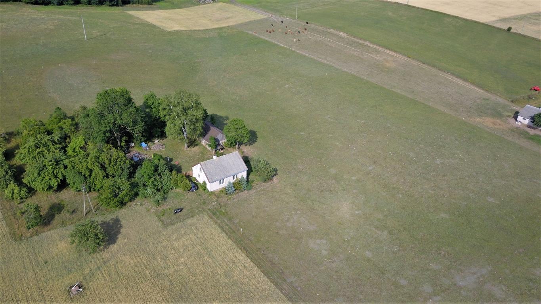 Nieruchomość gruntowa zabudowana, grunty rolne 6481m2.